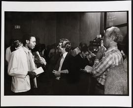 Reporter Al Wiman interviewing an unidentified man.