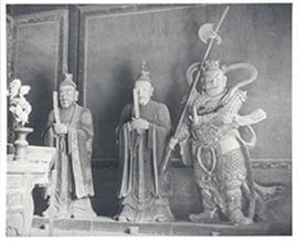 Interior view of a shrine with three statues, China.
