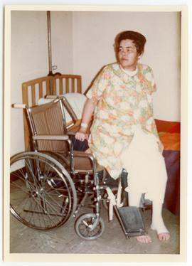 Patient moving from her bed to a wheelchair.
