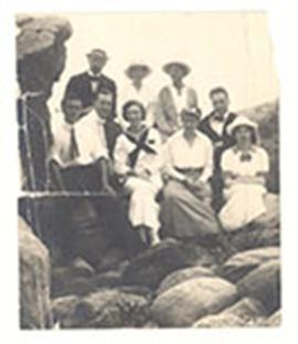Group portrait of men and women on an outing, including E.V. and Alice Cowdry.