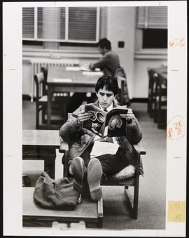 Unidentified student reading in the library.