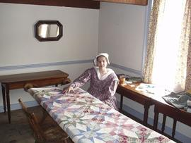 Woman quilting, Fort Mackinac, Michigan.