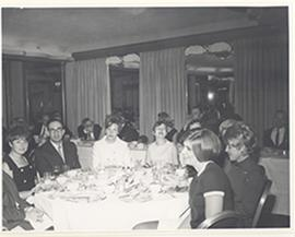Group portrait of men and women at a banquet table at a reception for the first Cori Lecture, Ros...