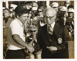 Lee Trevino shaking hands with an unidentified official, Greater St. Louis Golf Classic.