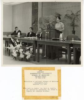 Estelle Brodman speaking from a podium at the dedication of the National Library of Medicine, Bet...