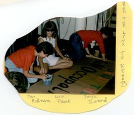 Jan Hollmann, Lisa Pazak, and Sonya Townsend painting a banner, Washington University School of M...