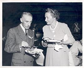 Alice Cowdry and Dr. J. Bouvier of Paris conversing while holding plates of food, Fourth Internat...