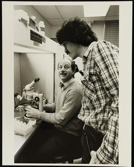 Dr. Gerald Fischbach and an unidentified man in a laboratory, Department of Anatomy and Neurobiol...