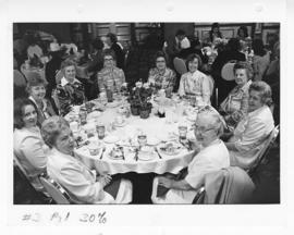 Ten women seated around a table at a St. Louis Children's Hospital Auxiliary Annual Fashion Show ...