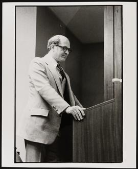 Portrait of Bernard T. Garfinkel standing at a podium.