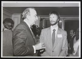 Paul E. Lacy and William Quillin conversing.