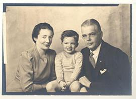 Studio portrait of a couple with a young child.