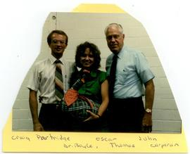 Group portrait of Craig Partridge, Mary Ann Boyle, and Oscar Thomas, Washington University School...