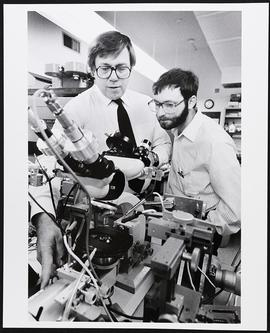 Dr. Robert Rakowski and an unidentified man, Department of Cell Biology and Physiology, Washingto...