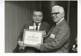 C. Alvin Tolin presenting a plaque to Donald L. Thurston, St. Louis Children's Hospital.