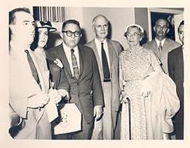 E.V. and Alice Cowdry in a group of men and women at a function.