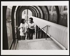 Unidentified students on the pedestrian bridge over Euclid Avenue.