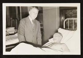 Portrait of Harry L. Alexander with a patient.