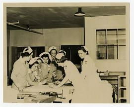 Two Occupational Therapists demonstrating crafts to a group of nurses, Wakeman General and Conval...