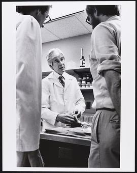 Dr. Walter Bauer with two unidentified students, Department of Pathology, Washington University S...