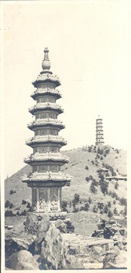 Ancient pagoda and second pagoda on a hill in the background, China.