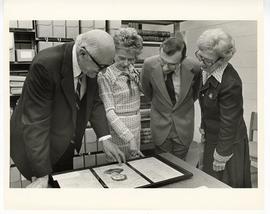 S. Richard Silverman, Mrs. Silverman, Donald A. Tatman, and Laurie McMillan Tatman examining an o...