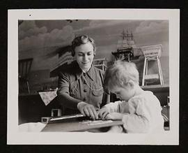 Estelle D. Claiborne with a young patient.