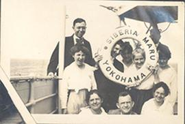 Paul H. Stevenson and wife June with a group of friends holding a livesaver aboard the steamship ...