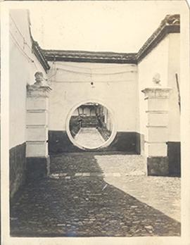 Paved enclosure with a circular door to a garden, China.