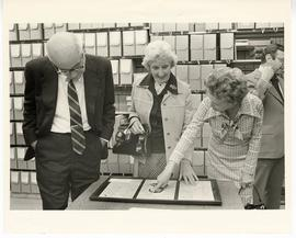 S. Richard Silverman, Mrs. Wolff, and Mrs. Silverman examining objects from the Max A. Goldstein ...