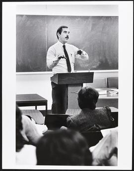 Dr. Robert Woodward giving a lecture, Health Administration Program, Washington University School...