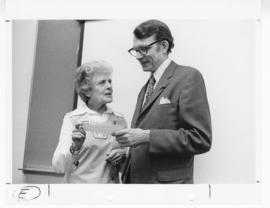 Harriett Spoehrer speaking with Philip R. Dodge.