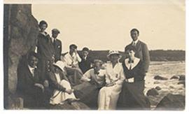 Group portrait of men and women on an outing, including Alice Cowdry.