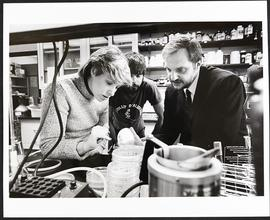 Dr. Daniel Hartl with two unidentified students in a laboratory, Washington University School of ...