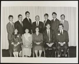 Group portrait of twelve men and women at an alumni awards dinner, Washington University School o...