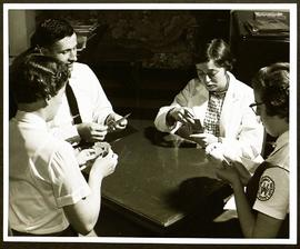 Four Washington University Occupational Therapy students playing cards.