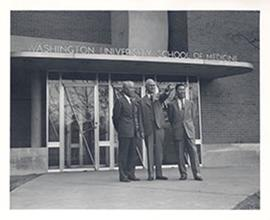 E.V. Cowdry standing on the steps of Washington University School of Medicine with Chancellor P. ...