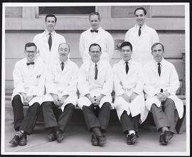 Group portrait of eight unidentified doctors.