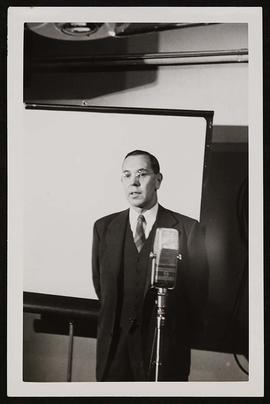 Frank R. Bradley speaking at a microphone.