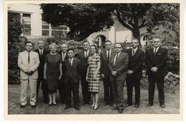 Group portrait with Alexander C. Sonnenwirth and ten unidentified men and women posed outside, In...