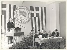 Carl F. Cori speaking from a podium at the Hellenic Society for Humanistic Studies' First Interna...