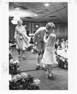 Two women and a young girl on the runway, St. Louis Children's Hospital Auxiliary Annual Fashion ...