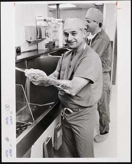 Portrait of Leroy Young preparing for surgery with David Martin.