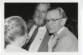 Ada Hanvey, Harry Fischer, and Dick Peters conversing, Evarts A. Graham Symposium reception.