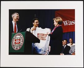 Unidentified student presenting Hillary Rodham Clinton with a Washington University School of Med...