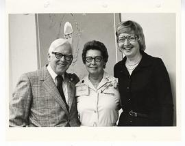 Group portrait ot C. Alvin Tolin, Carmen Walz, and Doris England at an appreciation party.