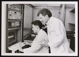 Unidentified anesthesiologists using computer equipment.