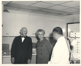 Mr. and Mrs. Arthur Lindburg with Joseph H. Ogura.