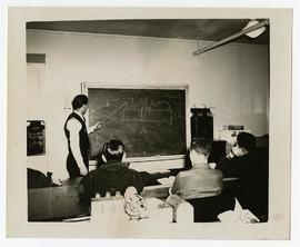 Man lecturing to three patients, Wakeman General and Convalescent Hospital, Camp Atterbury, Indiana.