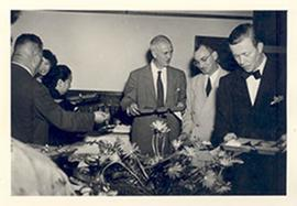 E.V. Cowdry and friends in line for the buffet with dinner trays at General Loo's house, Taipei, ...